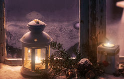 Christmas - candles glow in the steamy window Stock Image