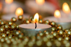 Christmas candles with golden decoration Stock Photo