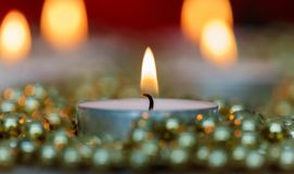 Christmas candles with golden decoration Royalty Free Stock Photography