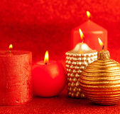 Christmas candles group on red glitter Stock Photos