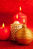 Christmas candles group on red glitter Royalty Free Stock Photo