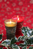 Christmas candles and holly Stock Photography