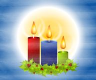 Christmas Candles and Holly 2. A clip art illustration of Christmas candles and a decorative holly wreath set on blue and white gradient textured background stock illustration