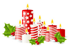 Christmas candles with holly berries Royalty Free Stock Photo