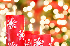 Christmas candles with light blur Stock Images