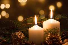 Christmas candles and lights. Christmas candles and ornaments over dark background with lights Stock Photo