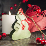 Christmas candles. Mulled wine with berries on a black background.n Stock Images
