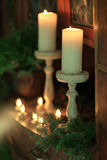 Christmas candles in needles Stock Photo