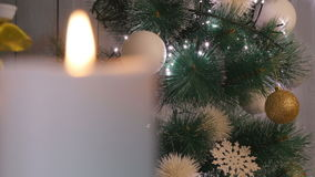 Christmas candles and ornaments over dark background with lights stock footage