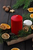 Christmas candles and ornaments. Christmas wreath with candle and christmas decorations background on wood Royalty Free Stock Images