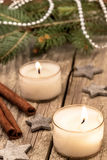 Christmas candles over a old wood background Stock Image
