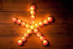 Christmas candles pentagram star on wood Royalty Free Stock Images