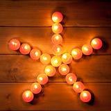 Christmas candles pentagram star on wood Royalty Free Stock Image