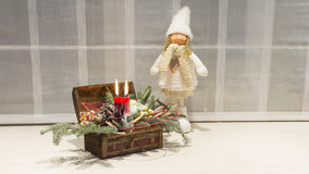 Christmas candles and pretty doll Stock Images