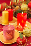 Christmas candles on a red background Stock Photo