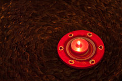 Christmas Candles. Red light of a warm light of a carpet woven rope Royalty Free Stock Image
