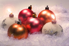 Christmas candles and red spheres. On the blue background Stock Photography