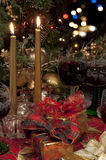 Christmas candles, red wine and presents. Stock Photos