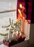 Christmas candles starting a fire. Advent candle wreath setting fire on a curtain Stock Images