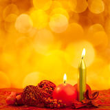 Christmas candles symbol with red leaves Royalty Free Stock Photos