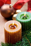 Christmas candles. Two christmas candles and bauble, still life. Rustic style Stock Photos