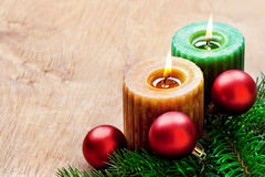 Christmas candles. Two christmas candles and bauble, still life. Rustic style Royalty Free Stock Photos