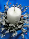 Christmas  candlestick. On blue background Stock Photos
