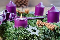 Christmas candlestick with burning candle Royalty Free Stock Image