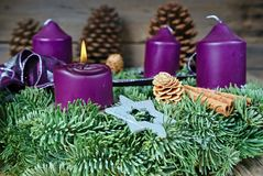 Christmas candlestick with burning candle Stock Photos