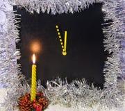 Christmas candlestick and clock Stock Photos