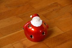 Christmas candlestick on parquet floor Royalty Free Stock Photo