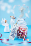 Christmas candy on blue background. Christmas candy post card angels on blue background Stock Photo