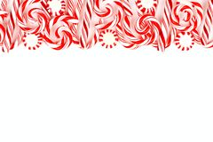 Christmas candy border with peppermints and candy canes over white Royalty Free Stock Photo