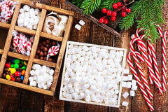 Christmas candy. In box and on a table Royalty Free Stock Photo