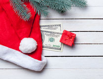 Christmas candy with brench and dollars Stock Photo