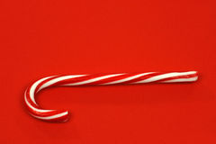 Christmas candy cane. On a red background Stock Photo