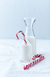 Christmas Candy Cane in a Bottle of Milk Royalty Free Stock Images