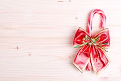 Christmas candy cane with bow on a blackboard bright colors Stock Image