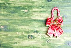 Christmas candy cane with bow on green blackboard Royalty Free Stock Image