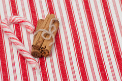 Christmas Candy Cane. Cinnamon Sticks. On Red Stock Image
