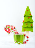 Christmas candy cane in the cup Royalty Free Stock Photography