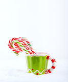 Christmas candy cane in the cup Royalty Free Stock Photos