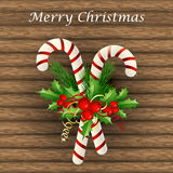 Christmas candy cane decorated with a bow and tree branches. Christmas candy cane decorated with a bow and Christmas tree branches Stock Photography