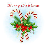 Christmas candy cane decorated with a bow and tree branches. Christmas candy cane decorated with a bow and Christmas tree branches Royalty Free Stock Photos
