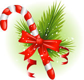 Christmas candy cane decorated with pine branches Stock Photography
