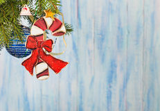 Christmas candy cane decoratin at left top corner of blue backgr Stock Photos