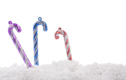 Christmas candy cane decoration with snow Royalty Free Stock Images