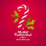 Christmas candy cane and holly greeting card Royalty Free Stock Photos