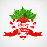 Christmas candy cane with holly and red ribbon Stock Photography