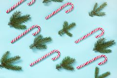 Christmas candy cane lied evenly in row on blue background. Flat lay and top view. Pattern Royalty Free Stock Image
